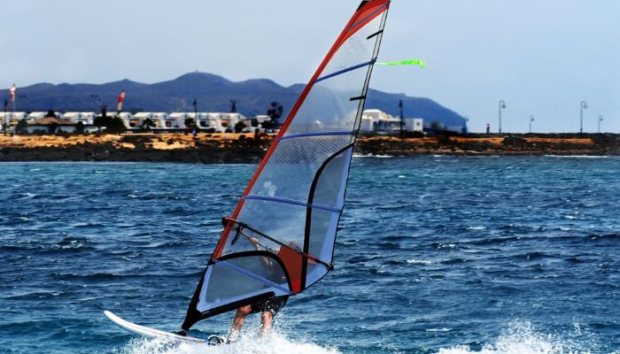 picture of someone windsurfing