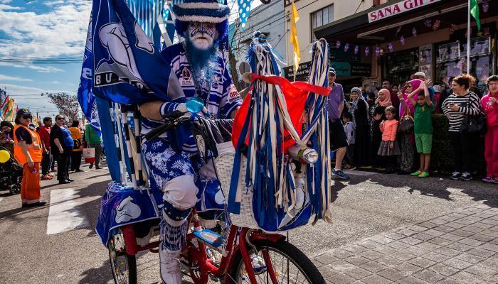 man in costume riding a bike